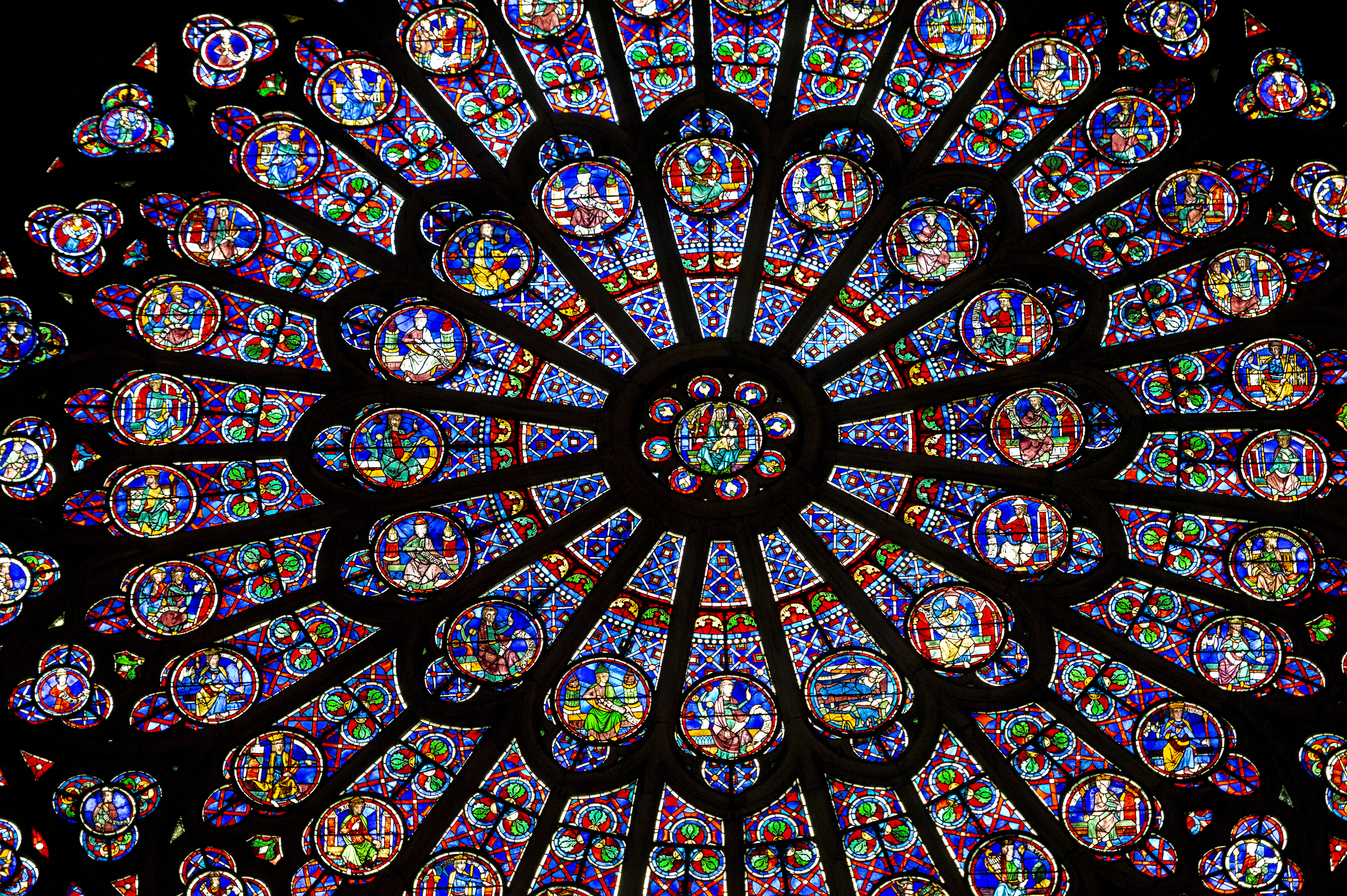 Interior of the Notre Dame de Paris cathedral with stained-glass windows, France. Notre Dame is one of the top tourist attractions in Paris. Inside the Gothic landmark of Paris.