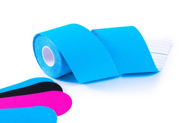 colorful kinesiology tape. Physiotherapy and therapeutic tape for wrist pain, aches and tension. elastic therapeutic tape. adhesive tape and alternative medicine.
