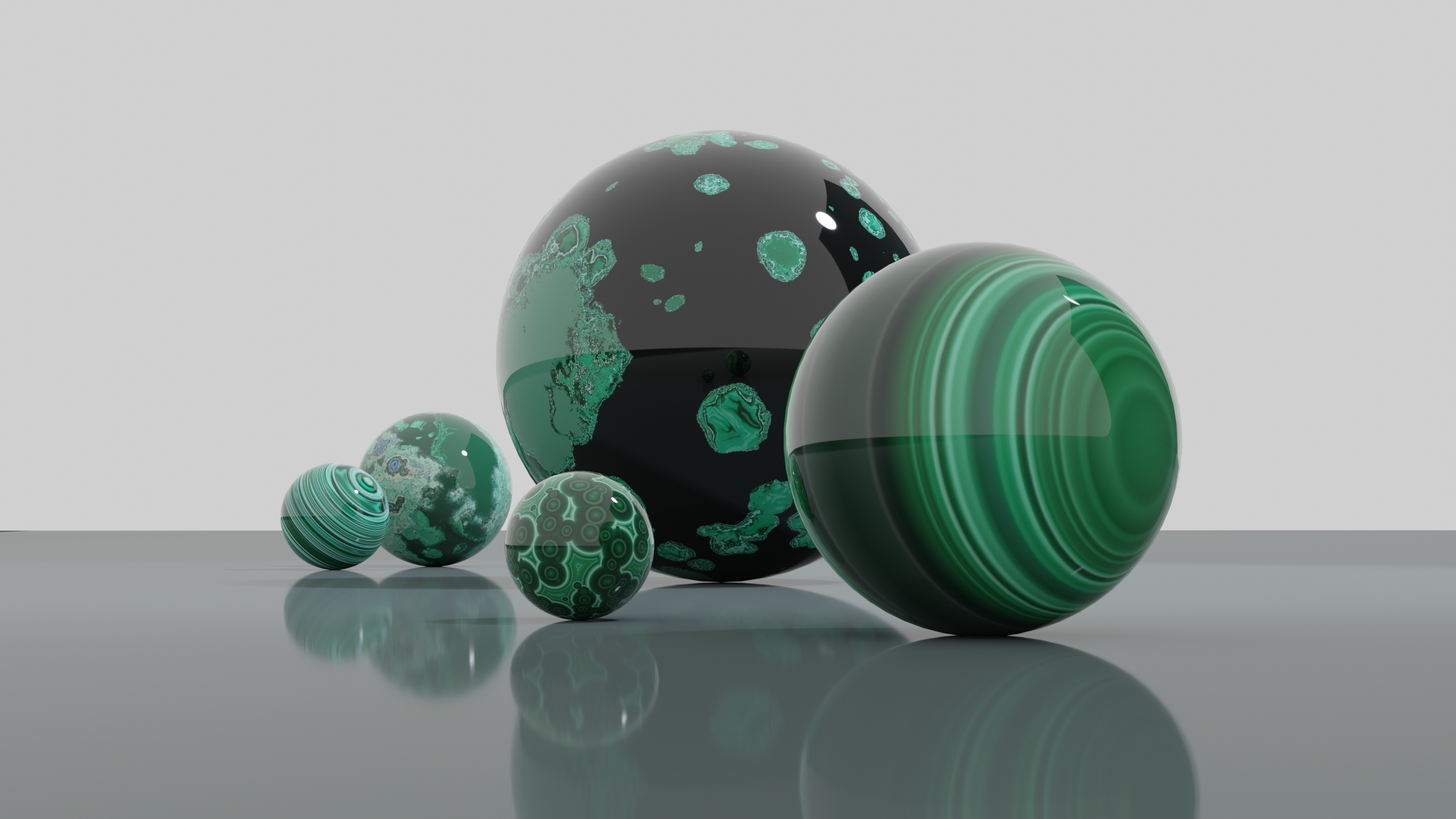 3D illustration of polished malachite mineral balls in bright light and grey-white background