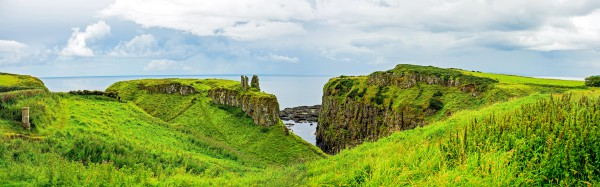 Ruins of Dunseverick Castle in Northern Ireland. Landscape of green cliffs on the emerald island.